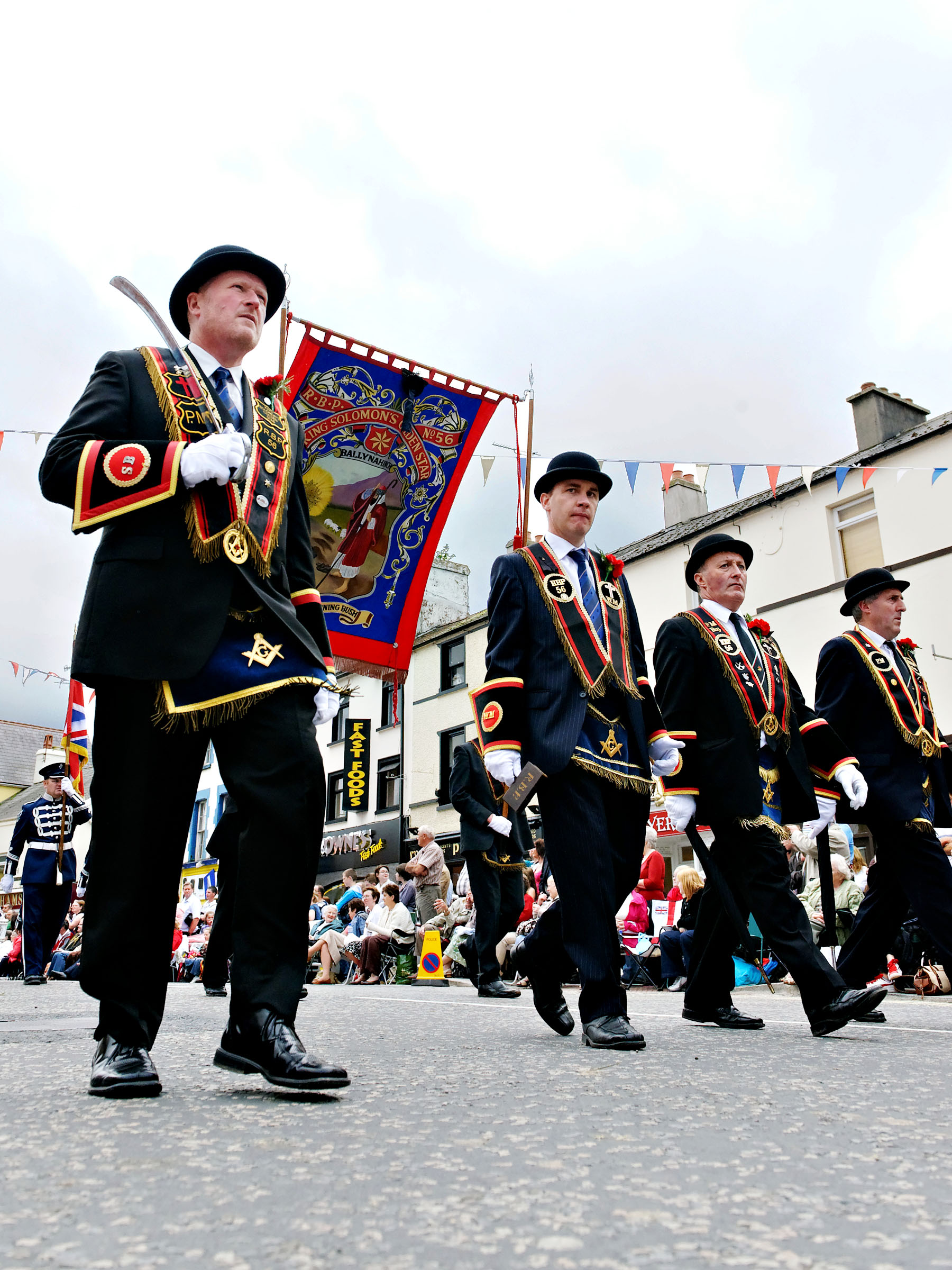 Office bearers of King Solomon's Golden Star RBP 56 (Ballynahinch) make their way through Dromore to the Black Saturday demonstration field.
